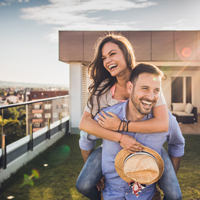 Fun couple at high-rise rooftop deck