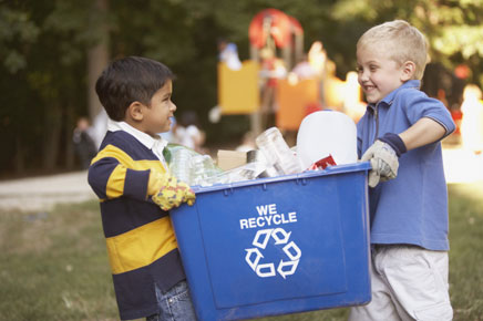 kids playing while, organizing a recycling program